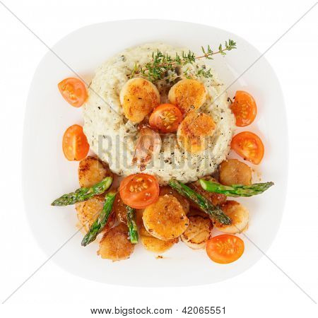 Risotto with pan seared sea scallops isolated on white background
