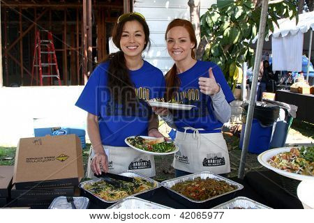 LOS ANGELES - FEB 9:  Theresa Castillo and Emily Wilson getting lunch at the 4th General Hospital Habitat for Humanity Fan Build Day at the 191 E. Marker Street on February 9, 2013 in Long Beach, CA
