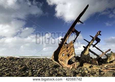 Shipwreck on rocky beach