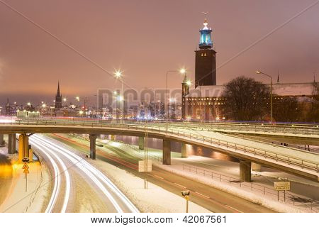 Stockholm Cityhall at night with transportation light trail Sweden