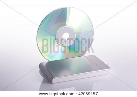 External Hard Disk And Blank Dvd On White Background With Reflection. Including Clipping Path.