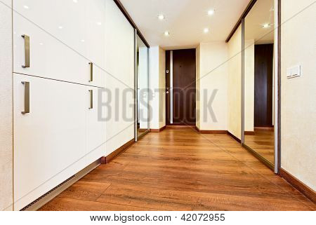 Modern minimalism style corridor interior with sliding-door mirror wardrobe