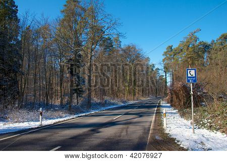 Forest Road With Emergency Sign