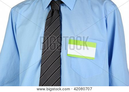 Blank nametag on businessman's blue shirt close up