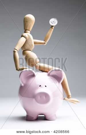 Saving Money Is So Easy Even A Dummy Can Do It.
