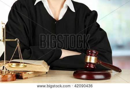 Judge sitting at table during court hearings on room background