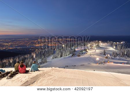 Skier And Snowboarder Waiting For Sunrise On Grouse