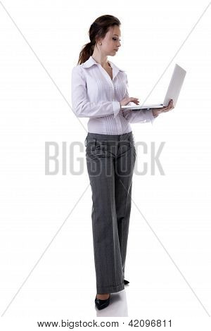 Businesswoman Working At A Laptop Full Length Isolated On White