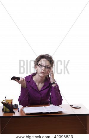 Businesswoman Looking Upset Wile Talking On The Cellphone Isolated On White