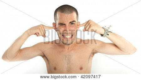 Young man covering his ears