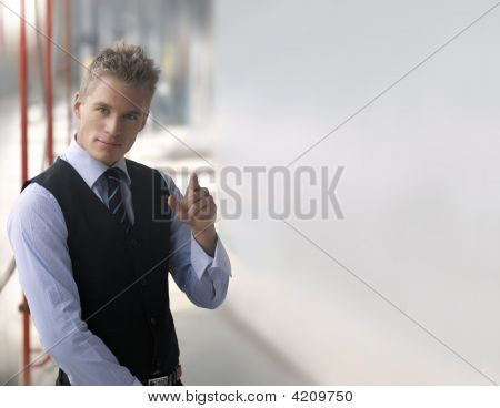 Pointing Young Businessman