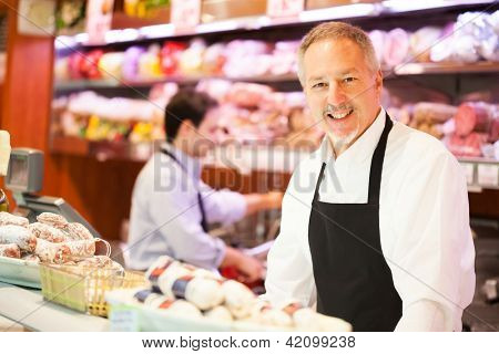 Shopkeepers at work in a grocery store
