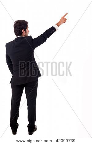 Young male business man pointing over white background