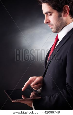 business man working with a tablet computer on black background