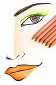 stock photo of face painting  - Drawing and coloring human face on paper using color pencils - JPG