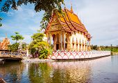 picture of sanctification  - A beatiful Buddhist temple in Thailand in a little isle in the middle of a lake - JPG