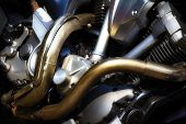 stock photo of exhaust pipes  - Motorcycle engine metalic background with exhaust pipes  - JPG