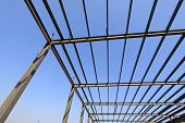 stock photo of girder  - steel structure framework under the blue sky in a factory north china - JPG