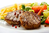 picture of barbecue grill  - Grilled steaks - JPG
