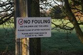 pic of dog-walker  - Sign to warn dog walkers that no fouling is permitted - JPG