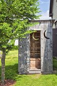 pic of outhouses  - A wooden outhouse ideally located in the backyard - JPG