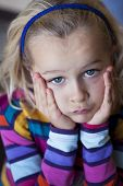 image of pouting  - Portrait of child grumpy and pouting looking at camera - JPG