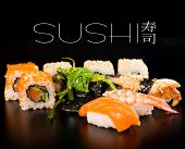 pic of dragon-fish  - Sushi set  on black background - JPG