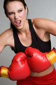 stock photo of boxing gloves  - Pretty young healthy woman wearing boxing gloves - JPG