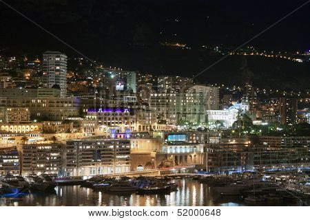 Monaco. Night view of the houses and the bay .