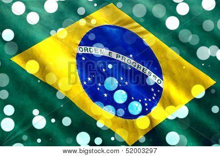 Brazilian flag closeup with confetti falling for Brazilian Carnival.
