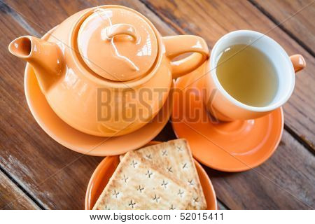 Hot Teapot With Cup And Crackers