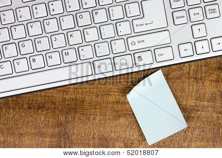 Computer Keyboard And Blank Memo