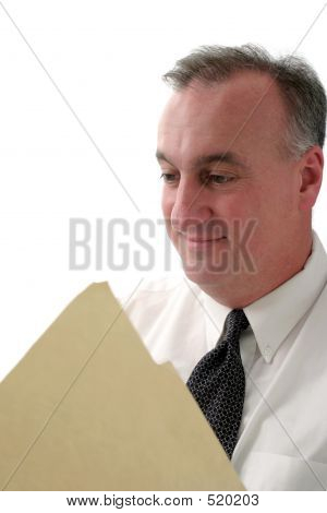 Smiling Business Man Reading Report