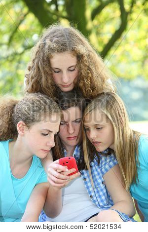 Teenage Girls Reading An Sms Message