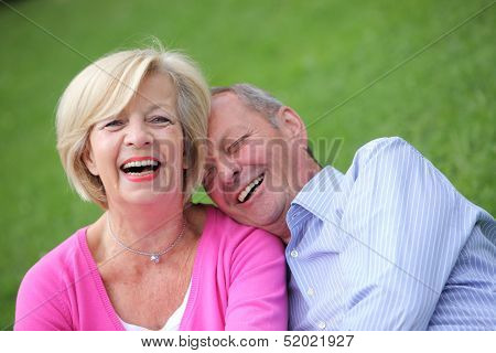 Happy Elderly Couple Laughing Together
