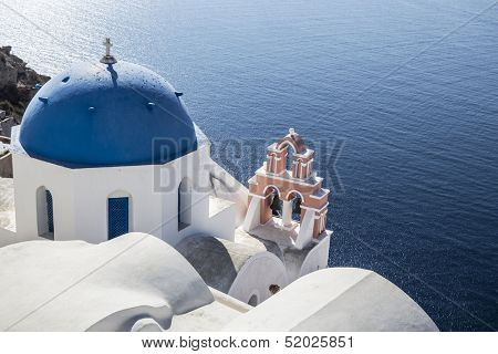Blue and white church of Oia village ,Santorini, Greece