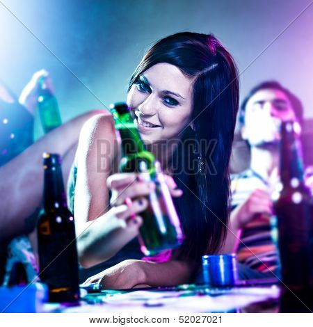girl at drug fueled house party with beer bottle.