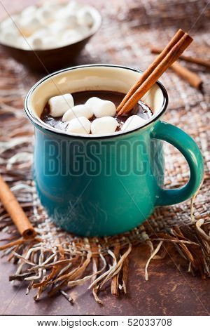 Hot chocolate with  marshmallows and cinnamon stick
