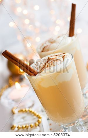 Eggnog with Cinnamon Sticks