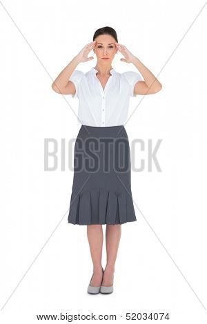 Apprehensive gorgeous businesswoman posing on white background