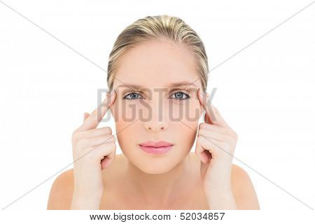 Thinking fresh blonde woman touching her temples on white background