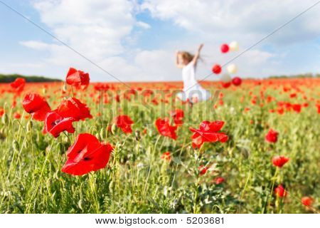 Happy Girl With Colorful Balloons Running In Poppy Field