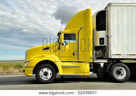 Yellow Truck On Highway