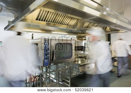 Team of chefs working in a commercial kitchen at a hurried pace