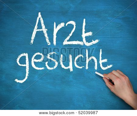Hand writing doctor wanted in german on blue board