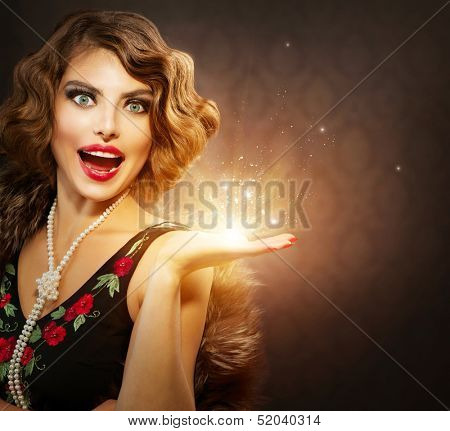 Retro Woman Portrait. Surprised Luxury Lady with Holiday Magic Gift in her Hand. Miracle Light. Copy Space