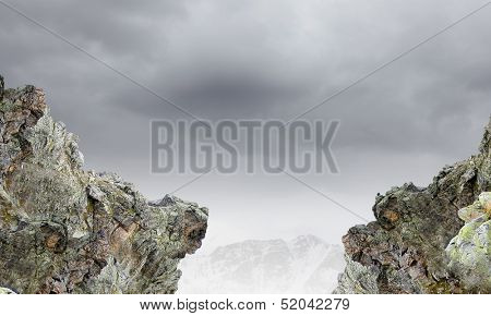 Gap between two rocks. Challenge and danger