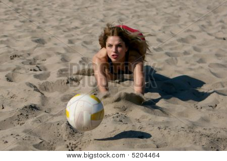 Beautiful Girl Playing Volleyball At Beach