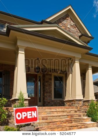 Luxury Model Home Angled Entrance With Open Sign