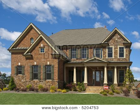 Model Luxury Home Exterior Front View Clouds